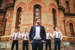 groom and groomsmen in front of church